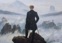 man_standing_on_mountain_256x180